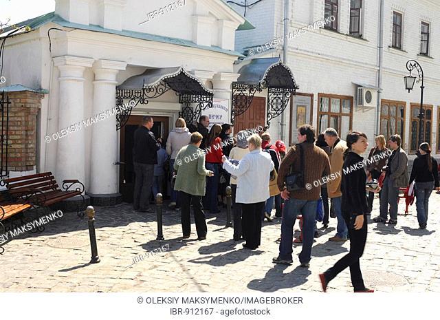 Group of tourists entering the caves of Kievo-pecherskaya lavra, Kiev pechersk lavra, cave monastery in Kiev, Ukraine, Eastern Europe