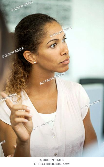 Businesswoman asking question in meeting