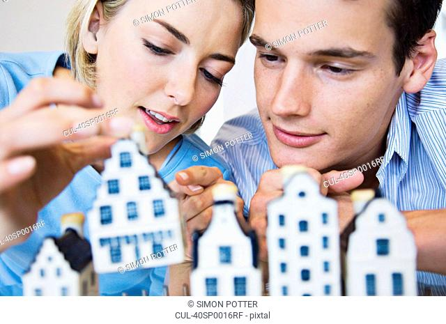 Couple examining model houses