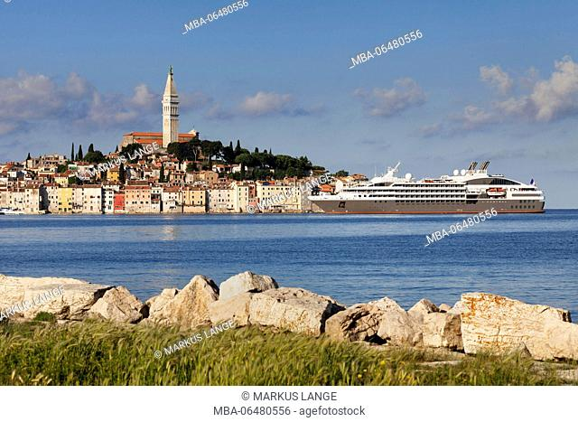 Old Town with the tower of the parish church Svete Eufemia and cruise ship, Rovinj, Istria, Croatia
