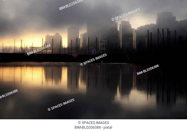 Early morning fog and mist over the waterfront and tall buildings of Vancouver