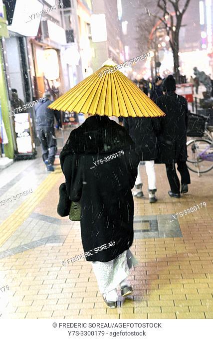 Japanese people walking in a street of Sapporo, Hokkaido, Japan, Asia