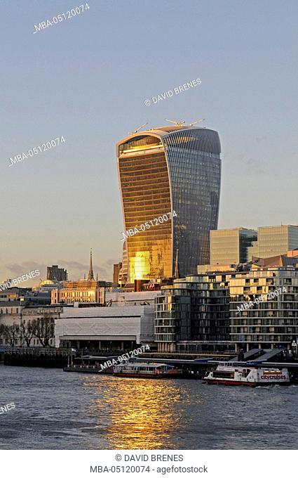 The Modern skyline of the City of London with The Walkie Talkie Building with sunlight reflected in the River Thames, London, England