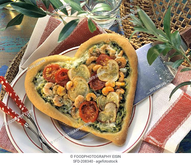 Pizza heart with shrimps, courgettes & cherry tomatoes