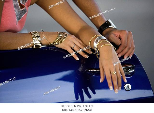 Close up of hip-hop couple's jewelry and bling