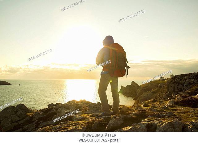 France, Bretagne, Camaret sur Mer, Mature man hiking at Atlanic coast