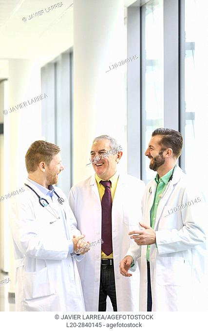 Doctors talking in corridor, Hospital