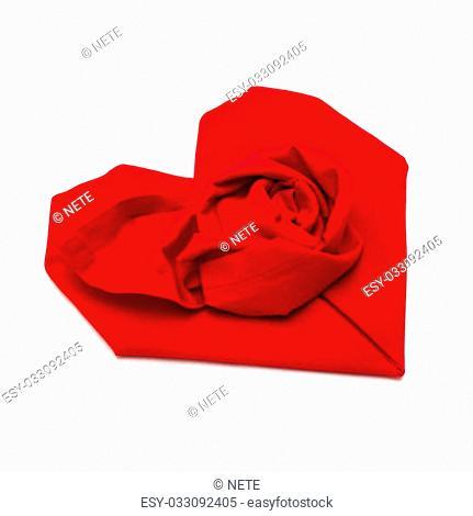 Folded napkin like a rose bud isolated on white background