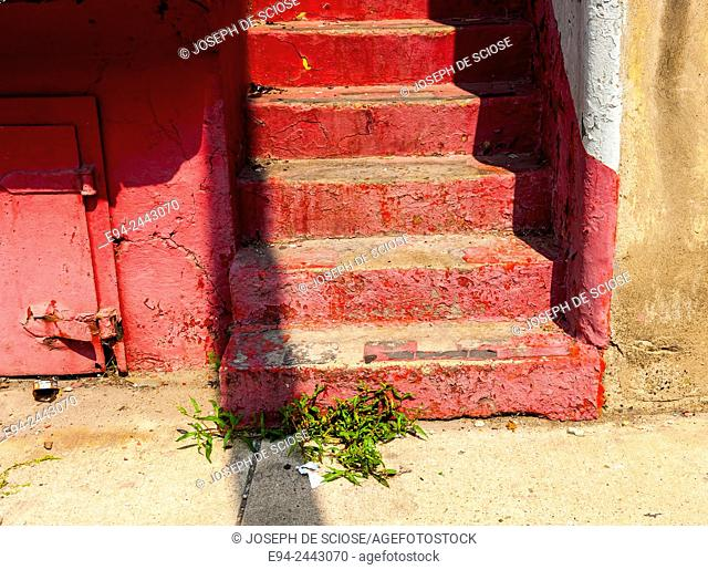 Red painted steps and a wall on a street in Pittsburgh