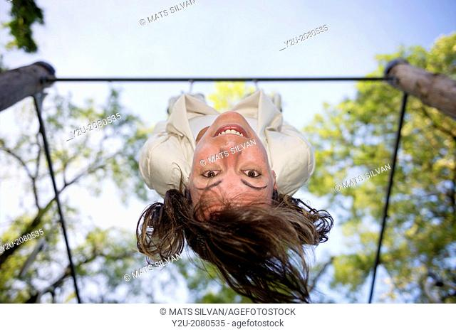 Woman hanging upside down in ticino switzerland