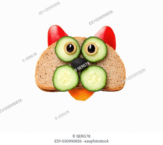 Funny cat made of bread and vegetables on white background