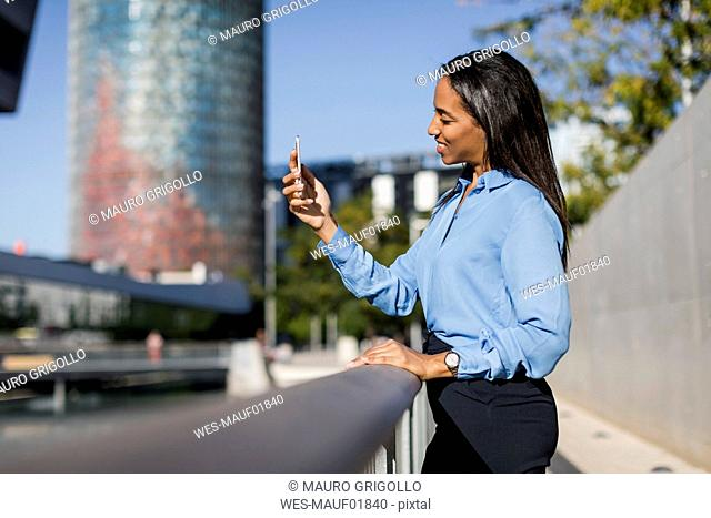 Businesswoman using smartphone