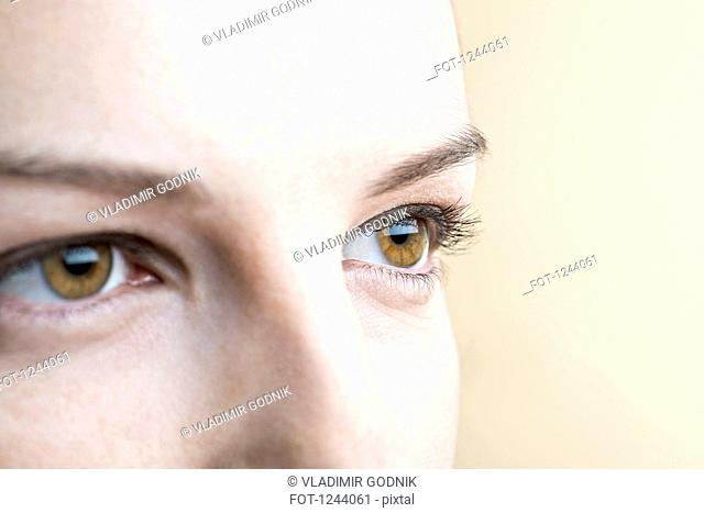 Close-up of woman's brown eyes