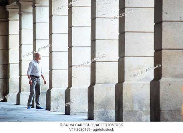 Columns of a portico on a street in old town of Santiago de Compostela, A Coruña, Galicia, Spain, Europe