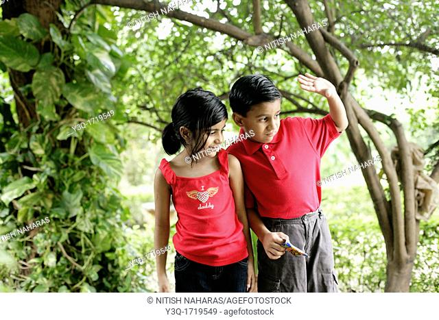 young boy and girl share a happy childhood moment together