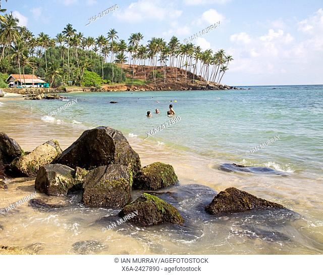 Tropical beach with people swimming Mirissa, Sri Lanka, Asia