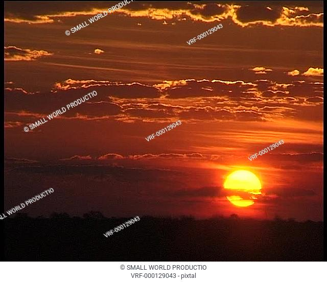 Red sunset with clouds. Namibia, W. Africa