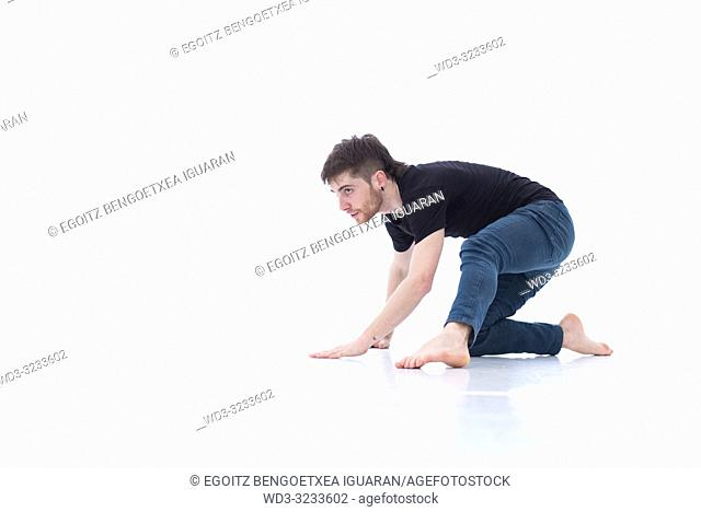 Casual dressed contemporary dancer on white background