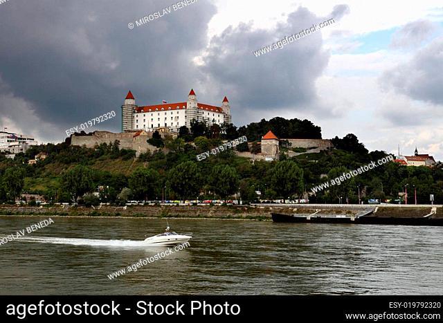 Bratislava (capital of Slovakia) castle with river Dunaj and motorboat