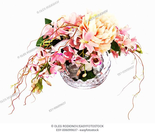 Bouquet from peon flowers and orchids in glass vase isolated on white background. Closeup