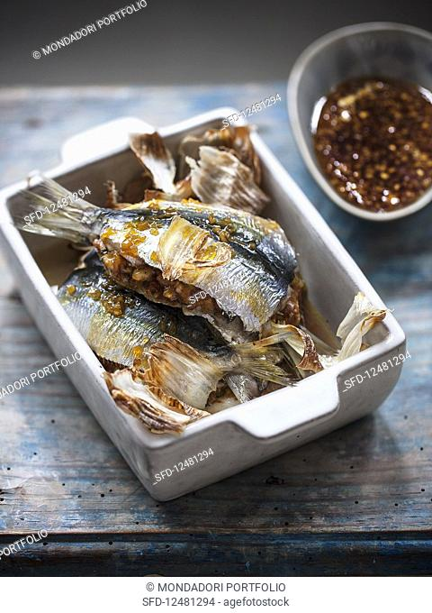 Stuffed sardines with garlic and orange caramel