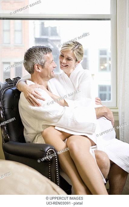 Woman sitting on husbandÆs lap