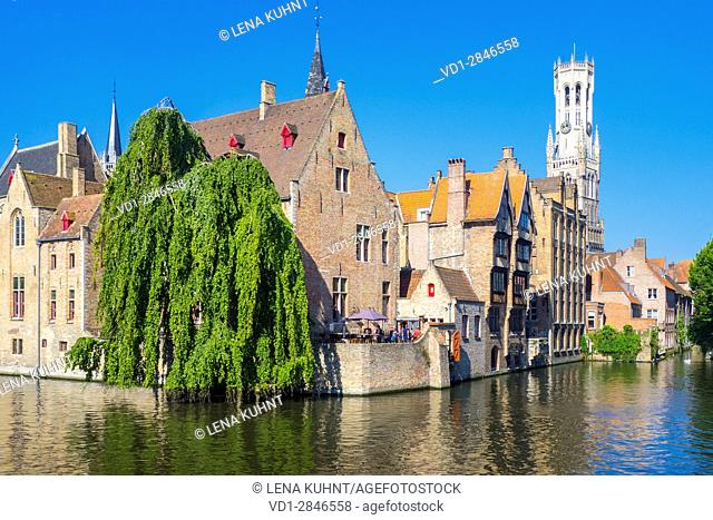 Belgium, West Flanders (Vlaanderen), Bruges (Brugge). Medieval buildings on the Dijver canal from Rozenhoedkaai at dawn