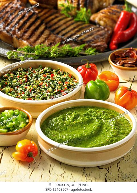 Grilled steaks with chimichurri sauces