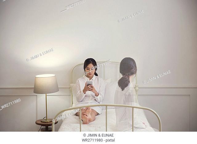 Woman depressed sitting on sofa
