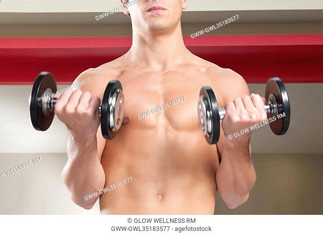Close-up of a man exercising with dumbbells