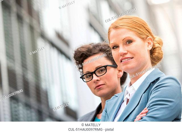 Businesswomen standing on city street