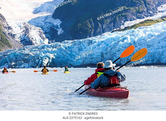 Sea Kayakers along the tidewater face of Harriman glacier, Prince William Sound, southcentral, Alaska