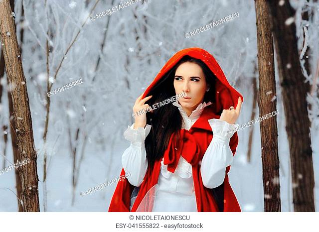 Mysterious girl with red cape walking in a fantasy magical wonderland