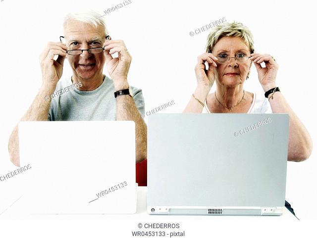 Portrait of a senior couple wearing their eyeglasses