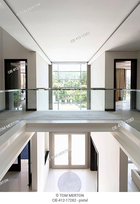 Modern balcony and open foyer in luxury home