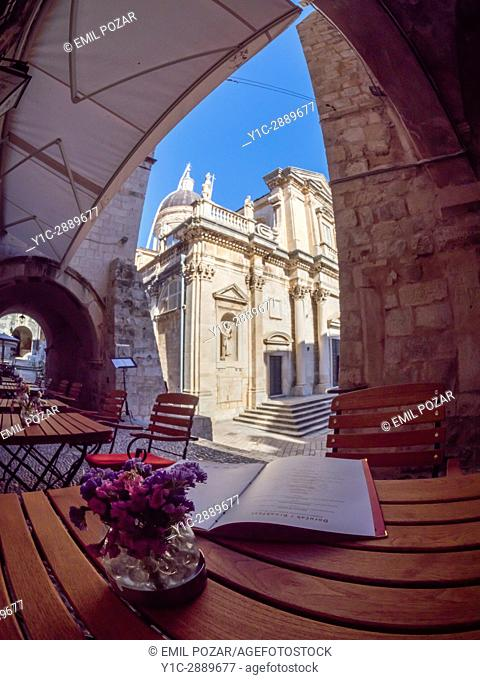 Restaurant and Cathedral in old town, Dubrovnik, Croatia