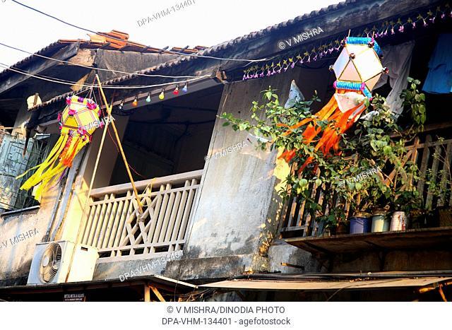 Deepawali Diwali festival ; lanterns hanging in the balcony ; Mumbai Bombay ; Maharashtra ; India