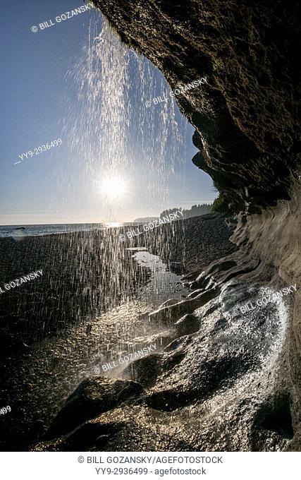 Waterfall at sunset on Sandcut Beach - Jordan River Regional Park - near Sooke, Vancouver Island, British Columbia, Canada