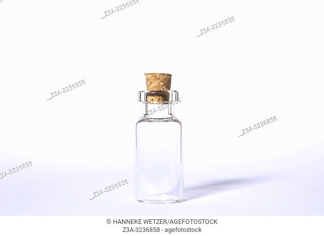 Glass Jar with Cork Stopper on a white background
