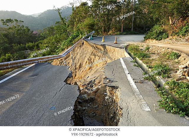 Landslide damage caused by typhoons and torrential rains on a mountain road in Okinawa