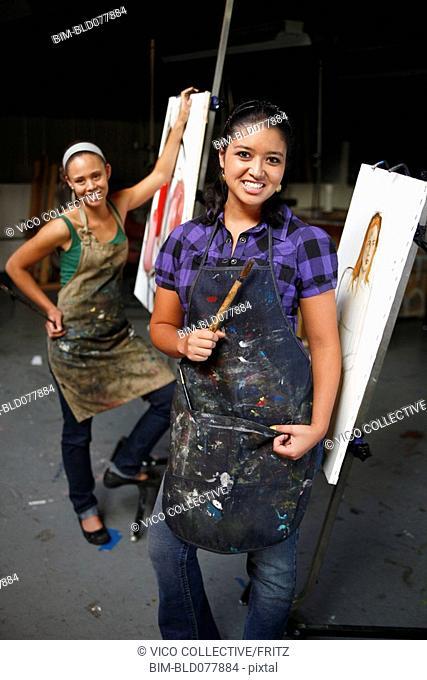 Women painting in artist studio