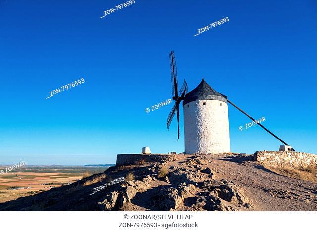 Preserved historic windmills on hilltop above Consuegra in Castilla-La Mancha, Spain