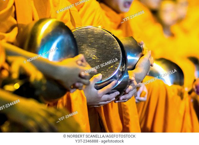 Asia. Thailand, Chiang Mai. Young Buddhist monks on their morning procession for offerings of food near a monastery in the Huay Kaew area