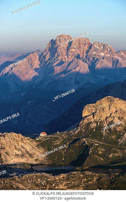 Sesto/Sexten, Dolomites, South Tyrol, Italy. First sunlight at Refuge Locatelli alle Tre Cime. In the background the Croda Rossa/Hohe Gaisl