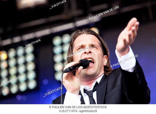 Roermond, Netherlands, Hans Teeuwen is performing and singing at Solar event