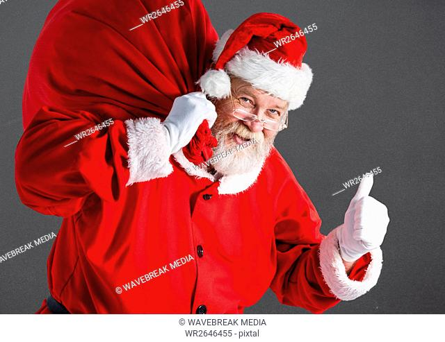 Santa with gift sack showing thumbs up