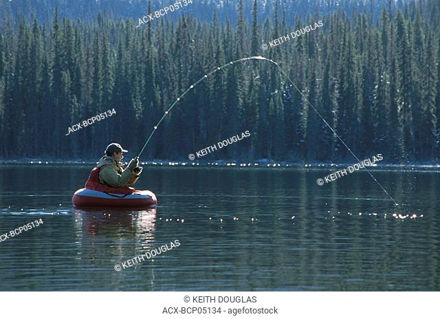 Flyfishing for trout from float-tube, Dennis lake, Bulkley Valley, British Columbia, Canada