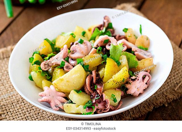 Potato salad with pickled octopus and green onions