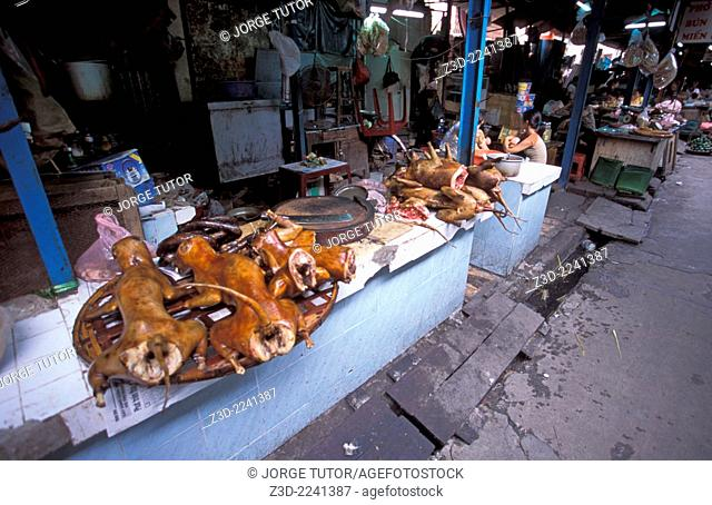 Cooked dog meat for sale in a street market Hanoi Vietnam
