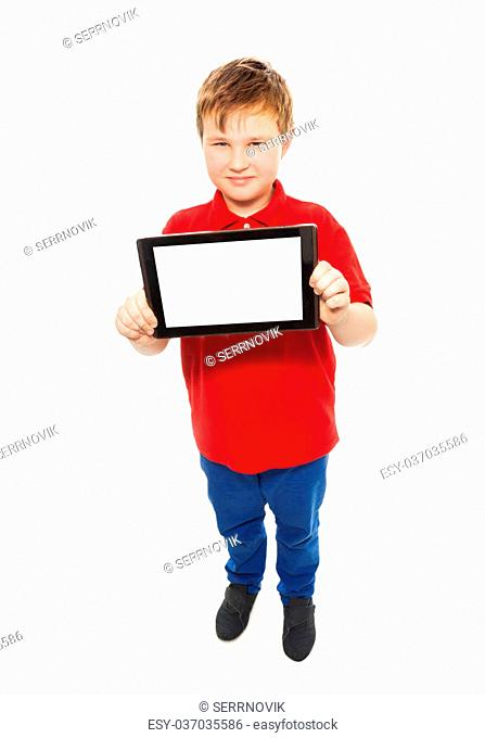 Smart Caucasian 10 years old boy showing digital tablet computer, standing isolated on white